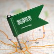Saudi Arabia Small Flag on a Map Background. — Stock Photo #44904683