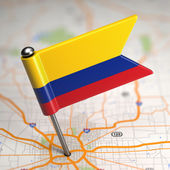 Colombia Small Flag on a Map Background. — Stock Photo