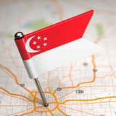 Singapore Small Flag on a Map Background. — Stock Photo
