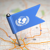 UNICEF Small Flag on a Map Background. — Stock Photo