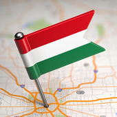 Hungary Small Flag on a Map Background. — Stock Photo