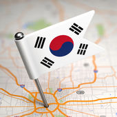 South Korea Small Flag on a Map Background. — Stock Photo