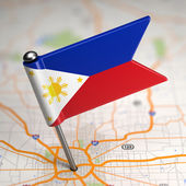 Philippines Small Flag on a Map Background. — Stock Photo