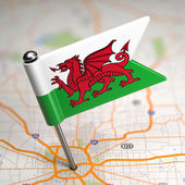 Wales  Small Flag on a Map Background. — Stock Photo