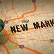 New Markets - Green Pushpin on a Map Background. — Stock Photo #45243465