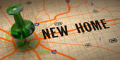 New Home - Green Pushpin on a Map Background. — Stock Photo