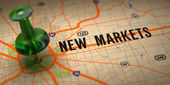 New Markets - Green Pushpin on a Map Background. — Stock Photo
