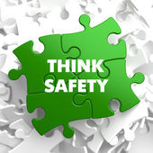 Think Safety on Green Puzzle. — Stock Photo