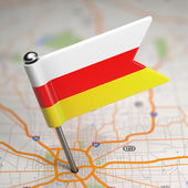 South Ossetia Small Flag on a Map Background. — Stock Photo