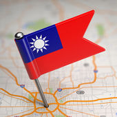 Taiwan Small Flag on a Map Background. — Stockfoto