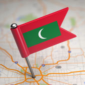 Maldives Small Flag on a Map Background. — Stock Photo
