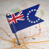 Cook Islands Small Flag on a Map Background. — Stock Photo