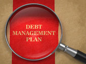 Debt Management Plan. Magnifying Glass on Old Paper. — Stock Photo