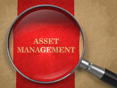 Asset Management. Magnifying Glass on Old Paper. — Stock Photo