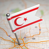 North Cyprus Small Flag on a Map Background. — Stock Photo