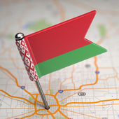 Belarus Small Flag on a Map Background. — Stock Photo