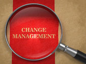 Change Management. Magnifying Glass on Old Paper. — Foto Stock
