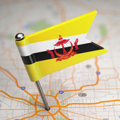 Brunei Small Flag on a Map Background. — Stock Photo