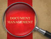 Document Management. Magnifying Glass on Old Paper. — Stock Photo