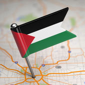 Palestine Small Flag on a Map Background. — Stock Photo