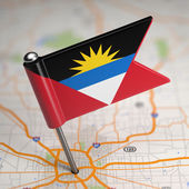 Antigua and Barbuda Small Flag on a Map Background. — Stock Photo