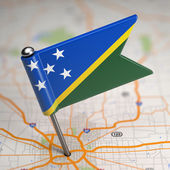 Solomon Islands Small Flag on a Map Background. — Foto Stock