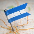 Постер, плакат: Honduras Small Flag on a Map Background