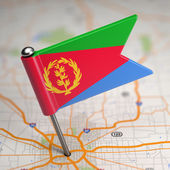 Eritrea Small Flag on a Map Background. — Stock Photo