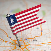 Liberia Small Flag on a Map Background. — Stock Photo