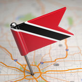 Trinidad and Tobago Small Flag on a Map Background. — Stock Photo