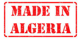 Made in Algeria - inscription on Red Rubber Stamp. — Stock Photo