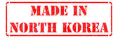 Made in  North Korea - inscription on Red Rubber Stamp. — Stock Photo