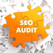 SEO Audit on Orange Puzzle. — Stock Photo