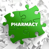 Pharmacy - Concept on Green Puzzle. — Stock Photo