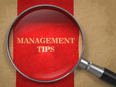 Management Tips Magnifying Glass on Old Paper. — Stock Photo