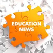 Education News on Orange Puzzle. — Stock Photo