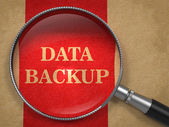 Data Backup Glass on Old Paper. — Stock Photo
