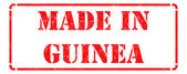 Made in Guinea on Red Rubber Stamp. — Stock Photo