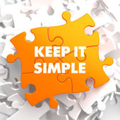 Keep it Simple on Yellow Puzzle. — Stock Photo
