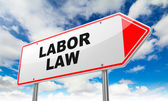 Labor Law on Red Road Sign. — Stock Photo