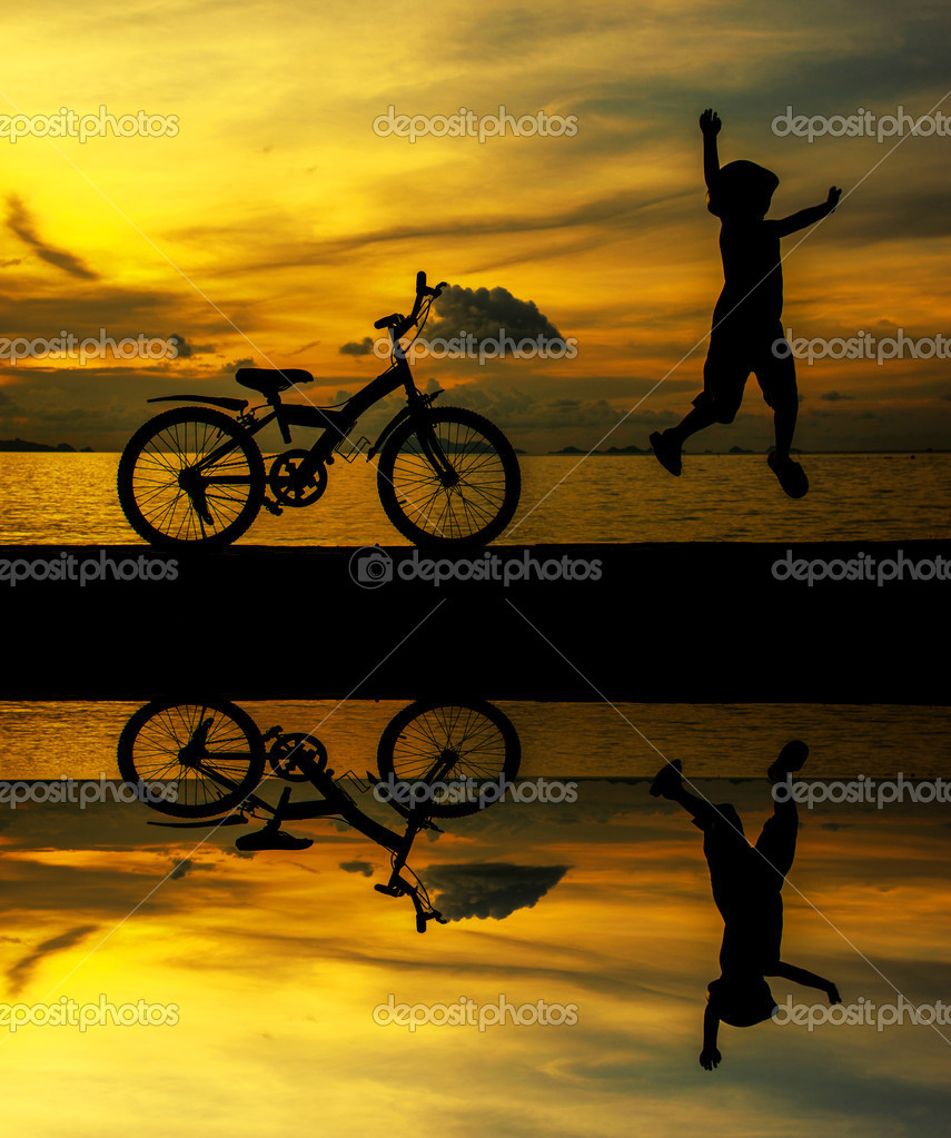 Silhouette of small boy on bike at dusk. — Stock Photo #14592129
