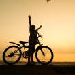 Silhouette of small boy with bycycle — Stock Photo