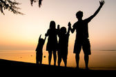 Silhouette of family on the beach — Stock Photo
