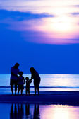 Family on the beach — Stock Photo