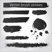 Set of vector grunge ink strokes and blot — Stock Vector