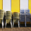 Stacks of Chairs and Tables - Stock Photo