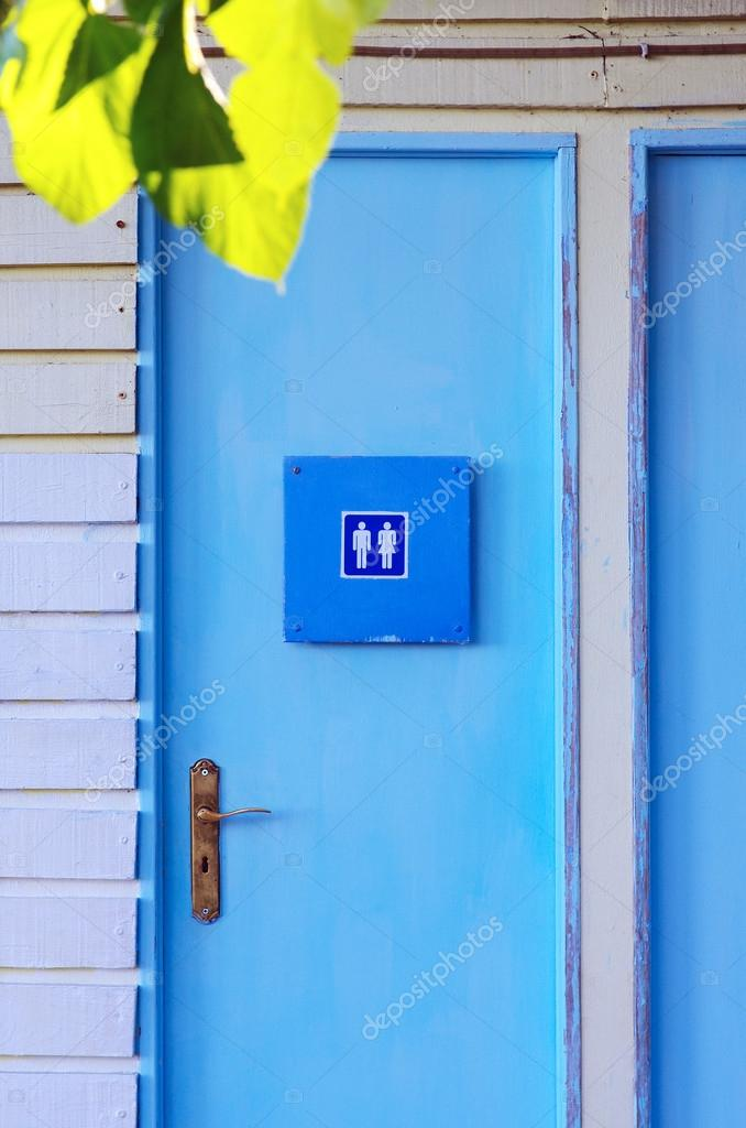Blue painted wooden door of a unisex water-closet facility — Stock Photo #13387184