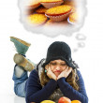 Unhappy woman looking at fruits — Stock Photo