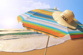 Sunshade and Straw Hat — Stock Photo