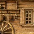 Old house with wheel — Stock Photo #48547647
